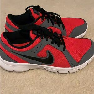 Red, black and grey Nike shoes